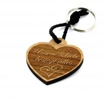 Gravur Schlüsselanhänger aus Holz - Modell: Liebe besiegt alles