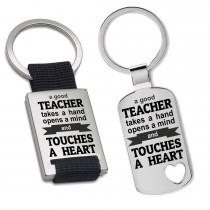 Schlüsselanhänger: A good teacher takes a hand